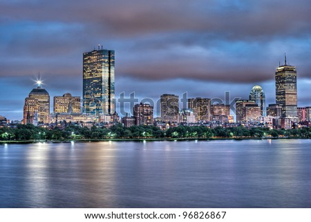 Evening view of the Boston Skyline with brightly illuminated buildings in HDR - stock photo