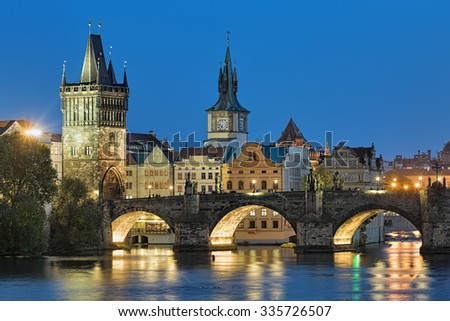 Evening view of the Charles Bridge in Prague, Czech Republic, with Old Town Bridge Tower and Old Town Water Tower - stock photo