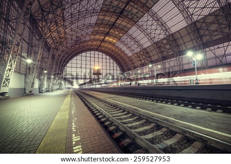 Evening view of the city railway station. - stock photo
