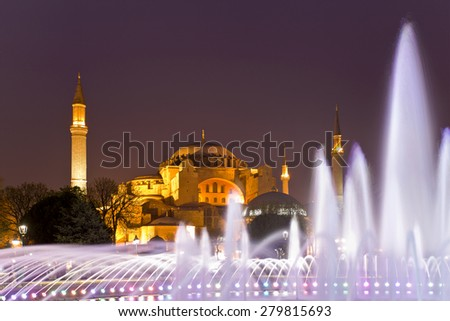 Evening view of the fountain, and Hagia Sophia. Colored fountain in a park in Istanbul. Main sightseeing in Istanbul. - stock photo