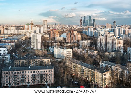 evening view of the residential and financial development of Moscow. Focus in the center of the frame - stock photo