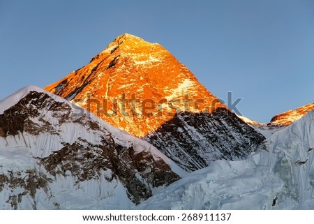 Evening view of top of Mount Everest from Kala Patthat, way to Everest base camp, Sagarmatha national park, Khumbu valley, Nepal - stock photo