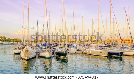 evening view of yachts at the Port Vell in Barcelona, Spain. Harbor at the sunset - stock photo