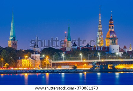 Evening view on the embankment of the Daugava River and the spiers of churches in Riga. - stock photo