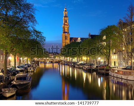 Evening view on the Westerkerk (Western church) from Prinsengracht channel in Amsterdam, Netherlands - stock photo
