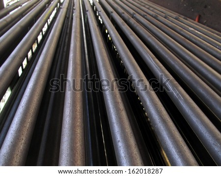 evenly stacked steel tubes of the heat exchanger, the water heater in the boiler grate as background - stock photo
