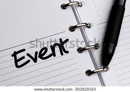Event word written on notebook - stock photo