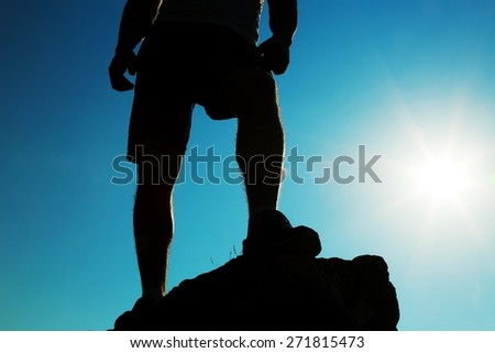 Everest. Man hiking silhouette in Himalaya mountains. Male hiker with backpack on top of mountain looking at beautiful night Mount Ama Dablam in Himalayas, Nepal - stock photo