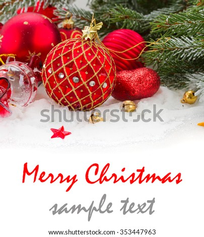evergreen fir tree and red christmas decorations  on white snow - stock photo
