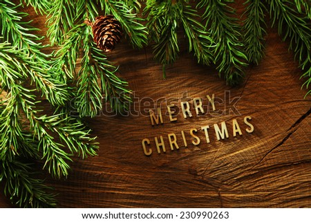 Evergreen tree background with Merry Christmas letters - stock photo