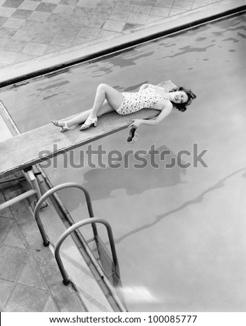 Everything's above board for young woman at the pool - stock photo