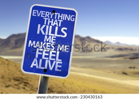 Everything That Kills Me Makes Me Feel Alive sign with a desert background - stock photo
