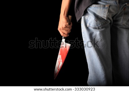 Evil criminal with large sharp knife ready for robbery or to commit a homicide isolated with clipping path inside - stock photo
