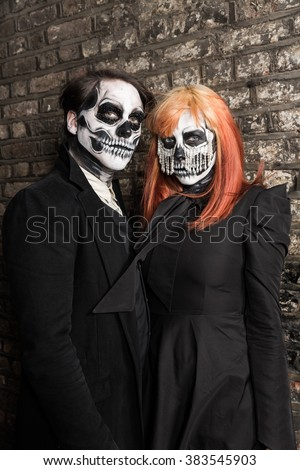Evil day of the dead undead couple posing - stock photo