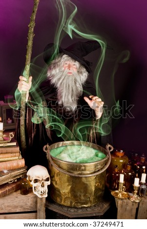 Evil sorcerer casting a spell on green poison soup - stock photo