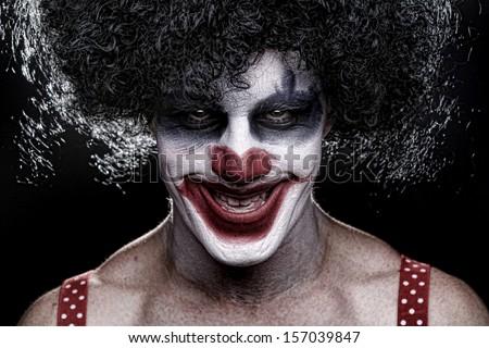 Evil Spooky Clown Portrait on Black Background - stock photo