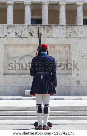 Evzones (presidential guards) at the Greek Parliament Building in front of Syntagma Square  in Athens, Greece - stock photo