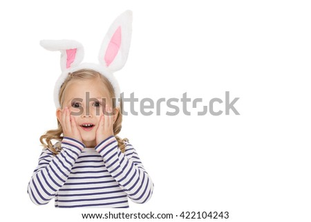 Exactly what she wished. Shot of a little girl looking excited to the camera  copyspace on the side on white background. - stock photo