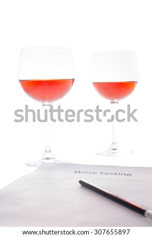 examination of the wine and notes the results - stock photo