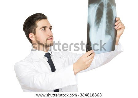 Examining carefully. Half length studio portrait of a male doctor examining an x-ray of the patient  - stock photo