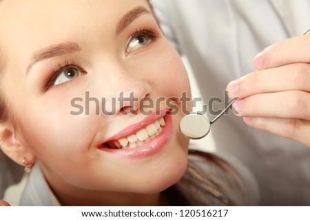 Examining patient's teeth - stock photo