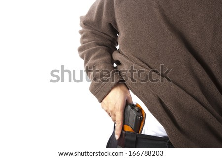 Example of concealed carry. Shot against a white background. - stock photo