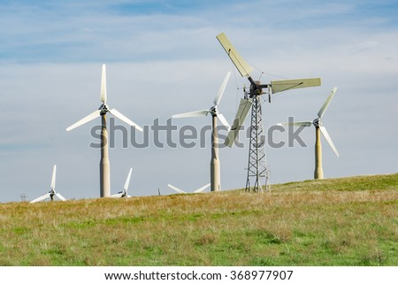 Examples of the obsolete wind turbines being replaced at the Altamont Wind Resource Area.  Modern replacement turbines should reduce the number of birds killed. - stock photo