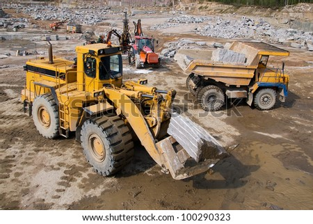 Excavation and dump vehicle in a granite quarry - stock photo
