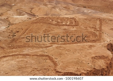Excavations of ancient Roman camp near Masada fortress in the desert - stock photo