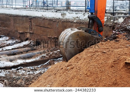 excavator arm and backhoe - stock photo