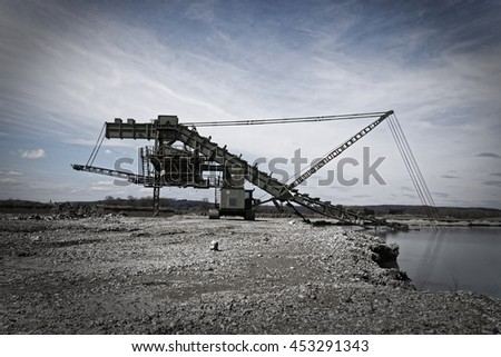 Excavator at a lake - stock photo