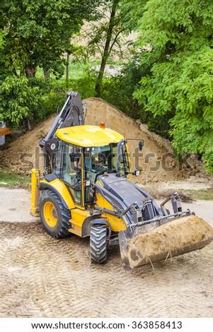 excavator at construction site - stock photo