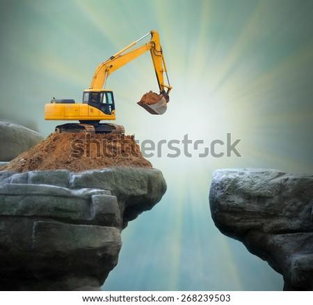 Excavator digging big hole.  - stock photo