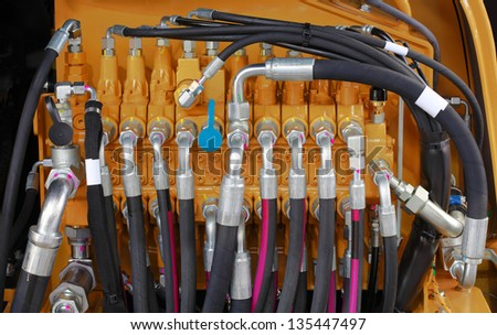 Excavator Hydraulic Pressure Hoses System - stock photo