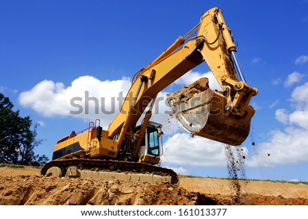 excavator in action - stock photo