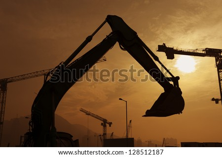 Excavator in construction site - stock photo