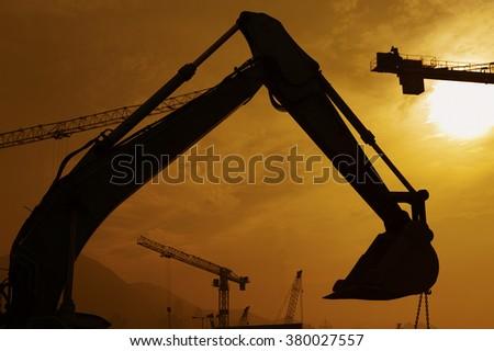 Excavator in construction site - stock photo