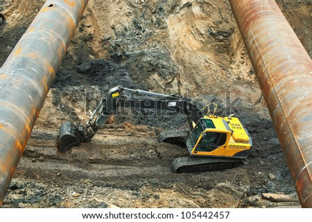 Excavator in open pit - stock photo