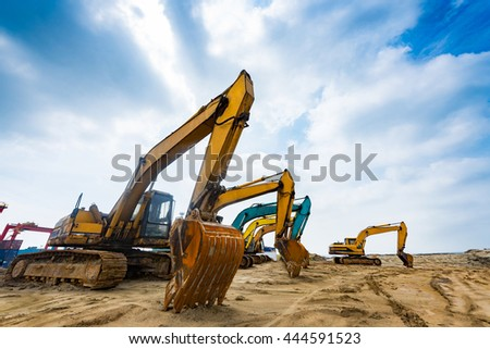 excavator In the blue sky white cloud background - stock photo