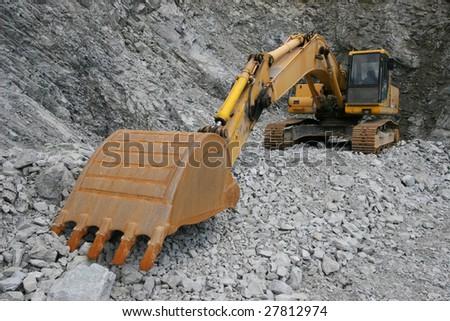Excavator in the quarry - stock photo