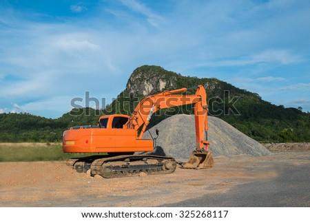 Excavator loader machine at construction site - stock photo