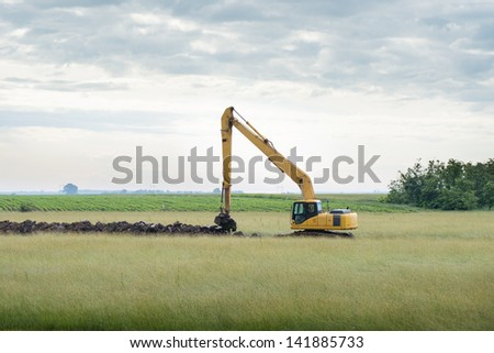 excavator loader machine during earthmoving - stock photo