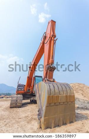excavator machine at excavation earthmoving work in sand - stock photo