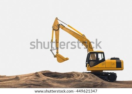 Excavator model on wooden with white background - stock photo