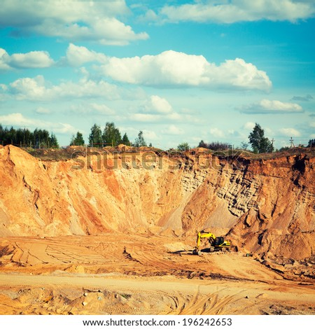 Excavator on a Sand Quarry. Heavy Industry Concept. Toned Instagram Styled Photo. - stock photo
