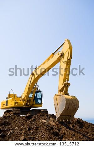 excavator on a working platform - stock photo