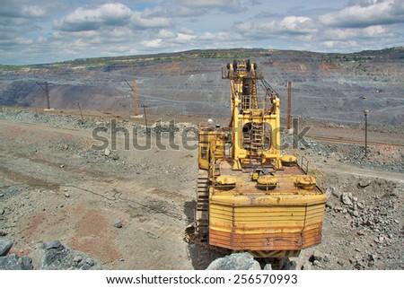 Excavator on the iron ore opencast - stock photo