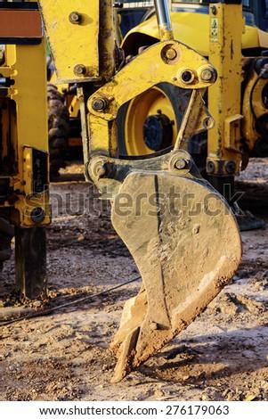 excavator scoop on the ground - stock photo