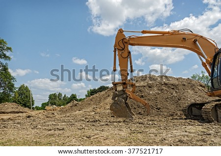 Excavator with Scoop at Construction Site - stock photo