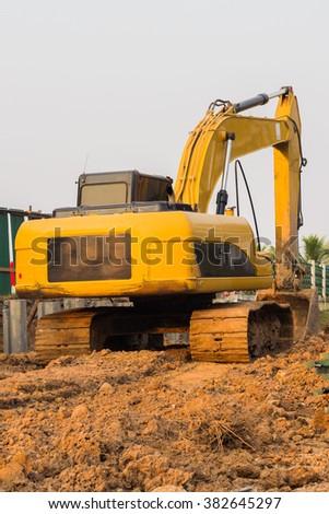 excavator working digging - stock photo